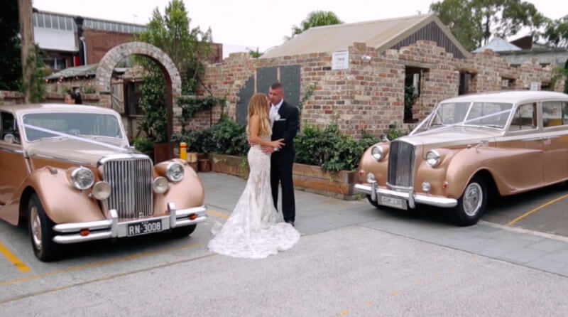 Classic wedding cars with bride and groom.